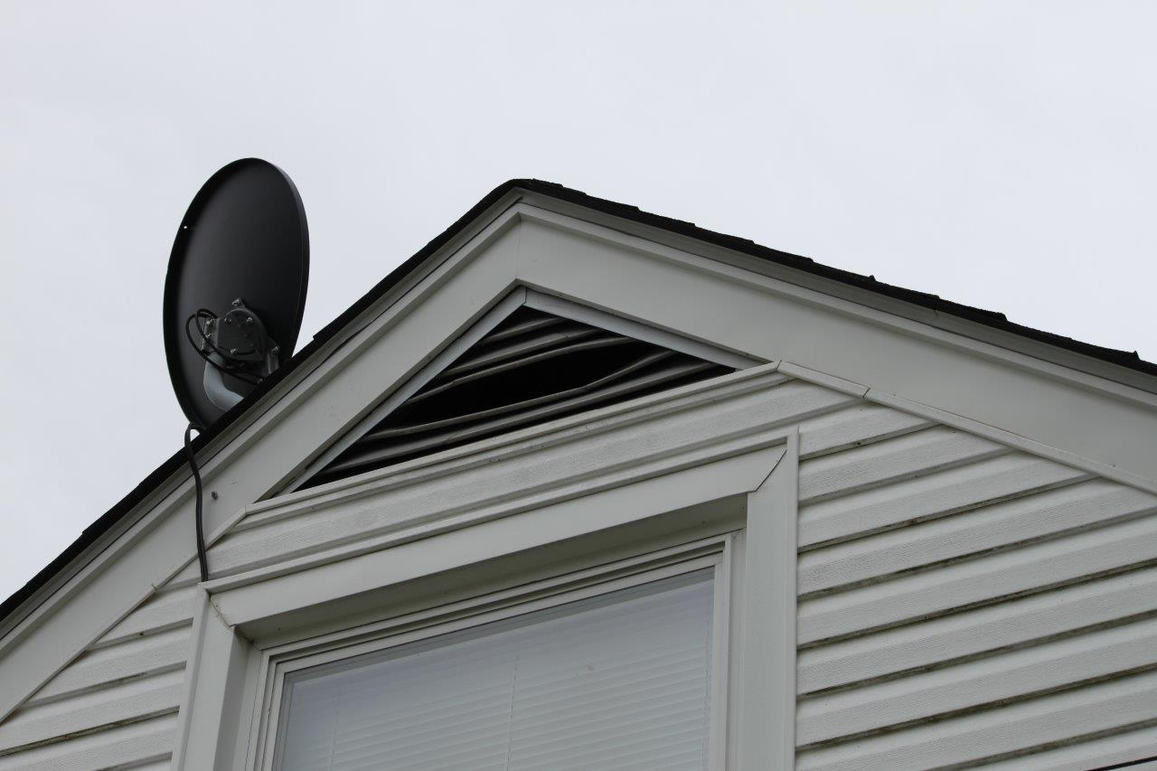 Gable end vent serving as a raccoon entry