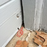 Unprotected garage door corners are a common mouse entry point