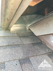 Raccoon exclusion process at a vinyl soffit return.