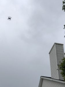 Image from the ground of the Trifecta Wildlife UAV in flight mid inspection